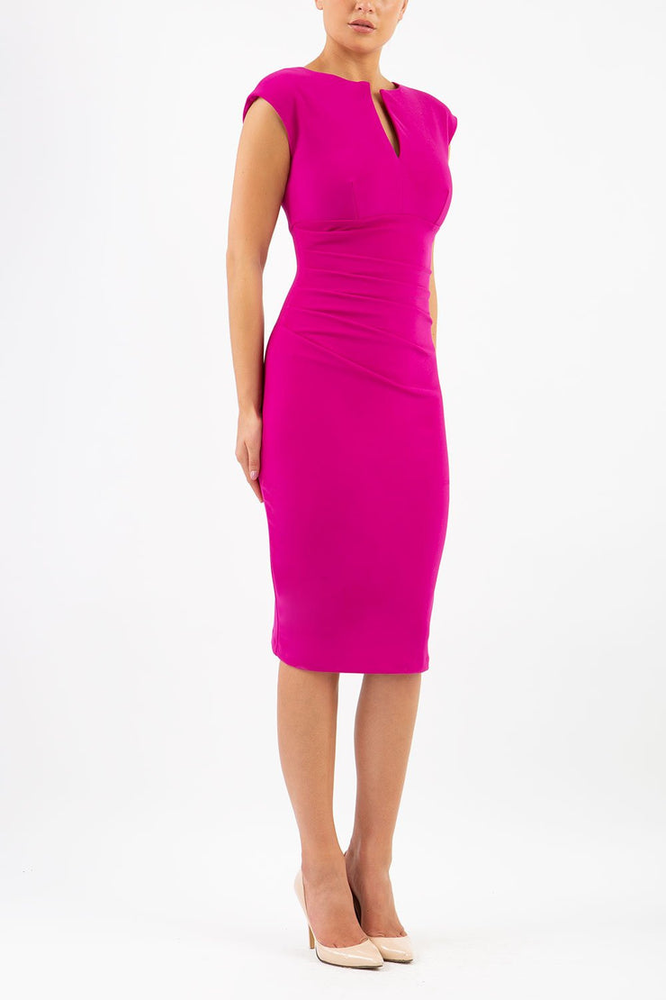 Model wearing Diva Catwalk Lydia Classic Sleeveless Bodycon Pencil Dress rounded neckline with slit in Magenta Haze front