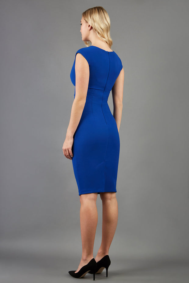brunette model wearing diva catwalk lydia sleeveless pencil flattering fitted plain dress with split neckline and pleating across the body cobalt blue back