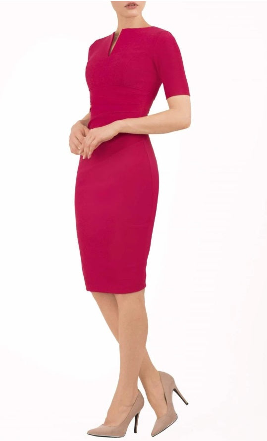 model is wearing diva catwalk lydia short sleeve pencil fitted dress in rose red colour with rounded neckline with a slit in the middle back