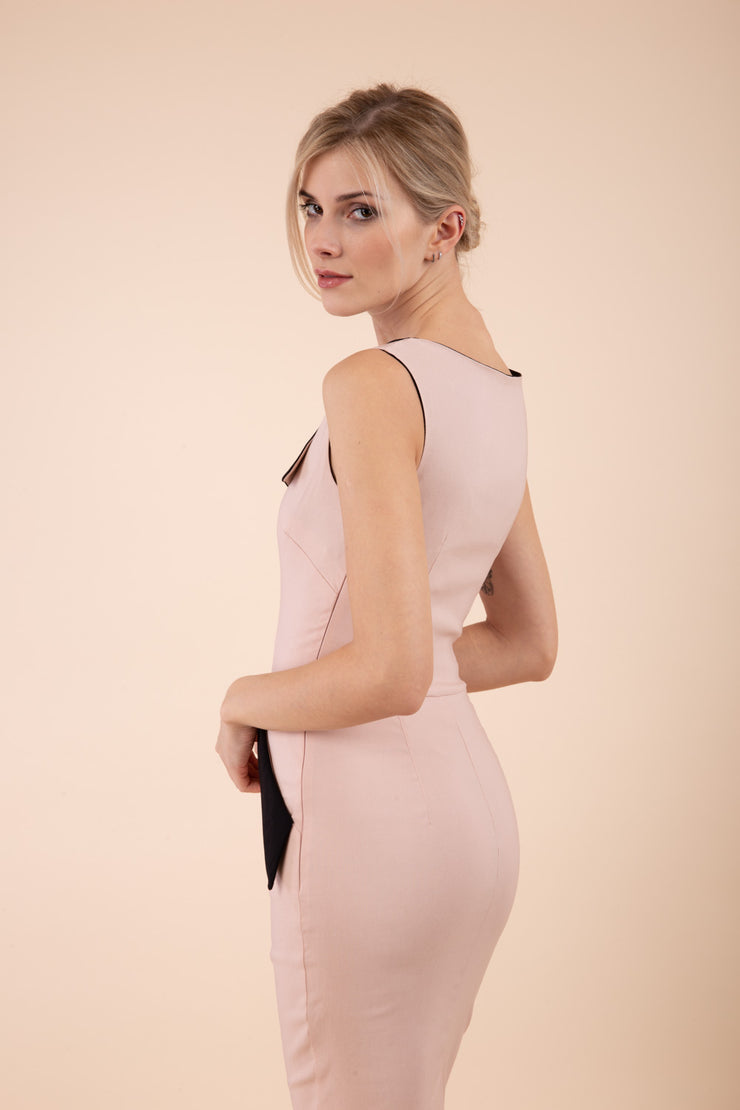 blonde model wearing diva catwalk chevy wiggle pencil dress without sleeves with side pocket detail and lowered v-neckline in nude pink back