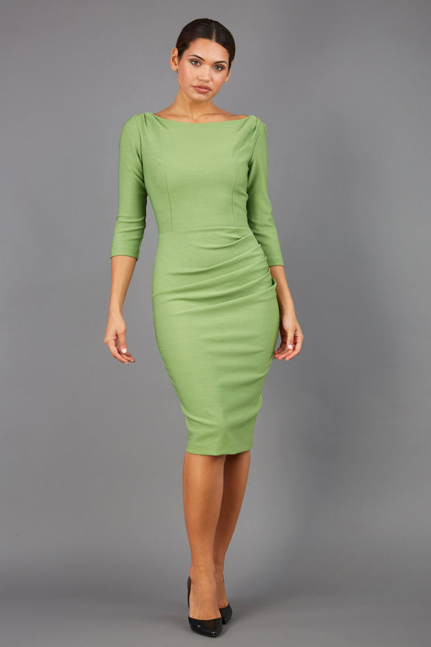 Model wearing the Seed Agatha in pencil dress design in green front image