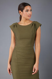 Model wearing the Seed in pencil dress design in olive green front image