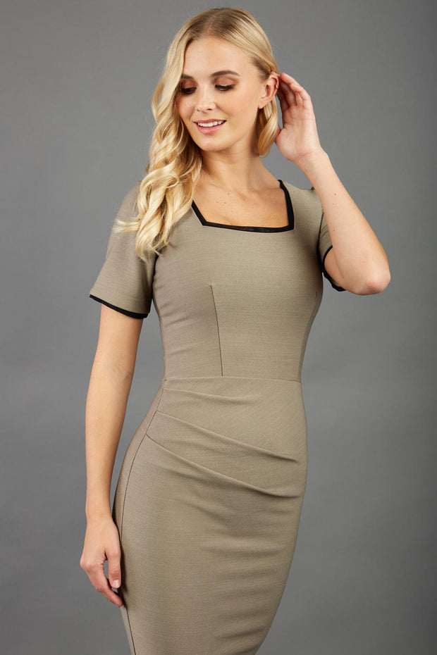 blonde model wearing seed albany contrasted pencil-skirt dress with short sleeves and pleating across the tummy with low square neckline and contrasted detail finishing in taupe brown front