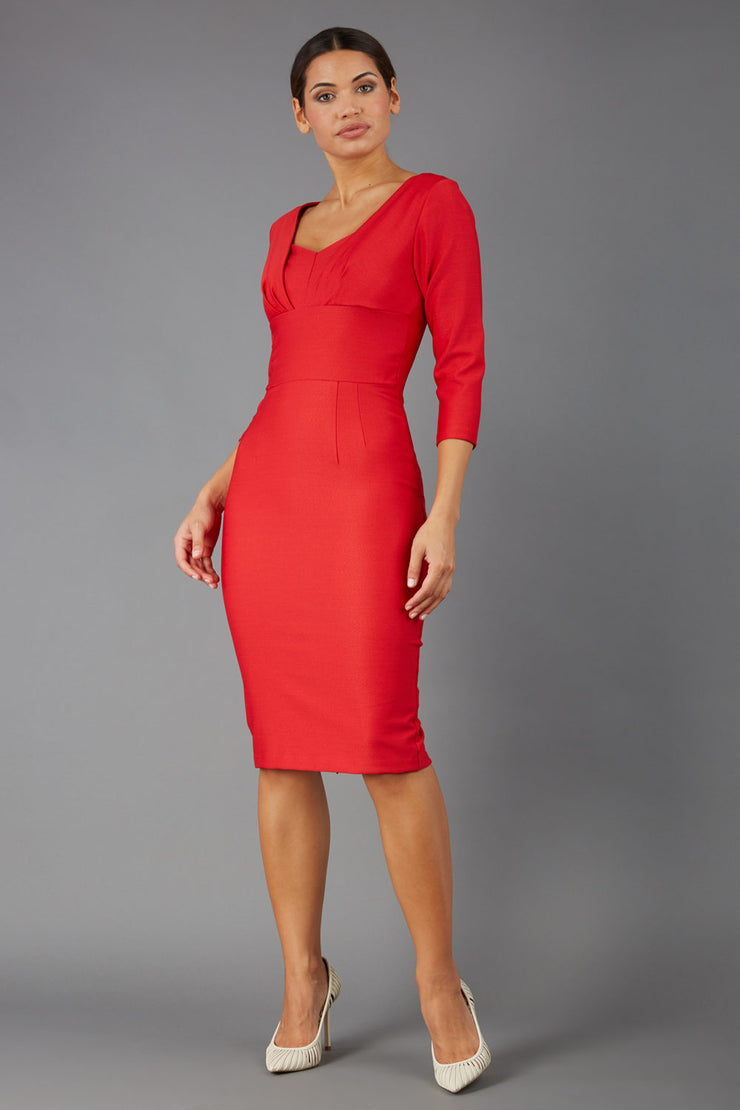 Model wearing the Seed in pencil dress design in red front image