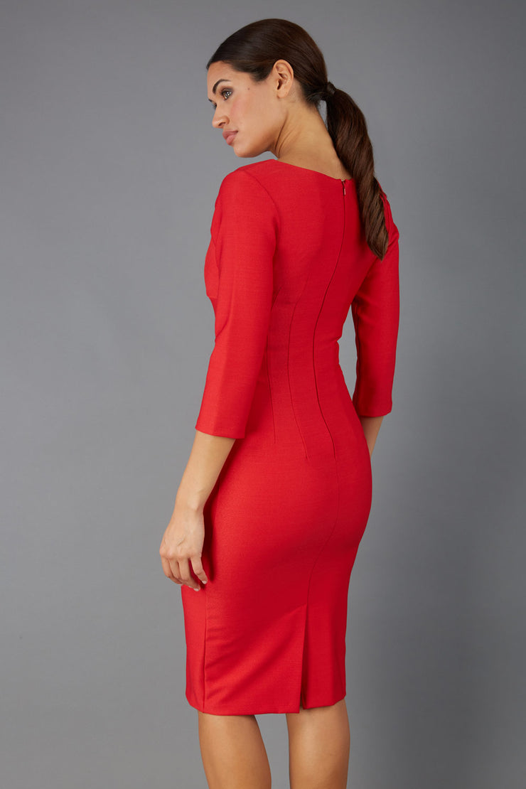 Model wearing the Seed in pencil dress design in red back image