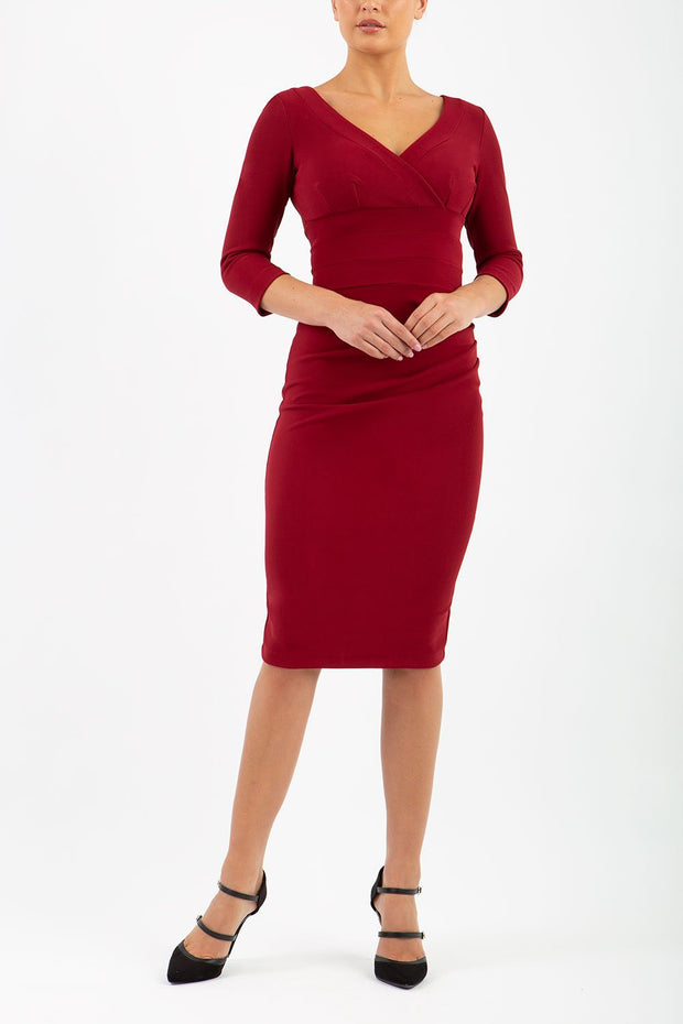 Model wearing the Diva Jemima dress in pencil dress design in merlot red front image