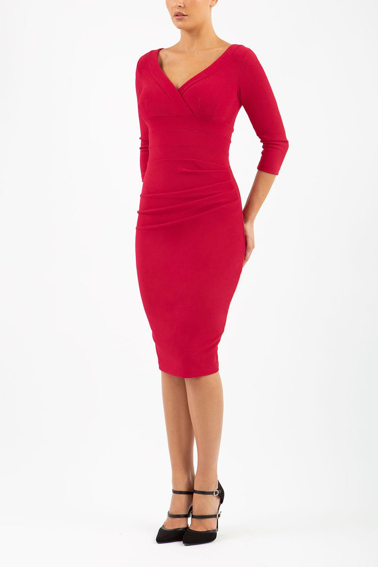 Model wearing the Diva Jemima dress in pencil dress design in cerise red front image