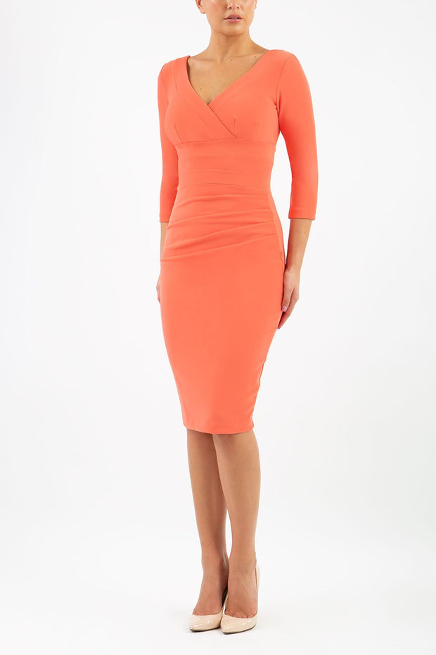 Model wearing the Diva Jemima dress in pencil dress design in sea coral front image