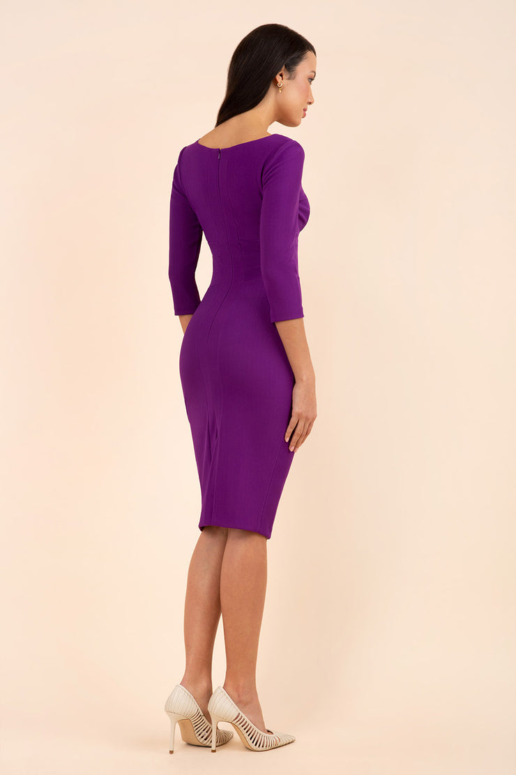 Model wearing the Diva Jemima dress in pencil dress design in violet purple back image
