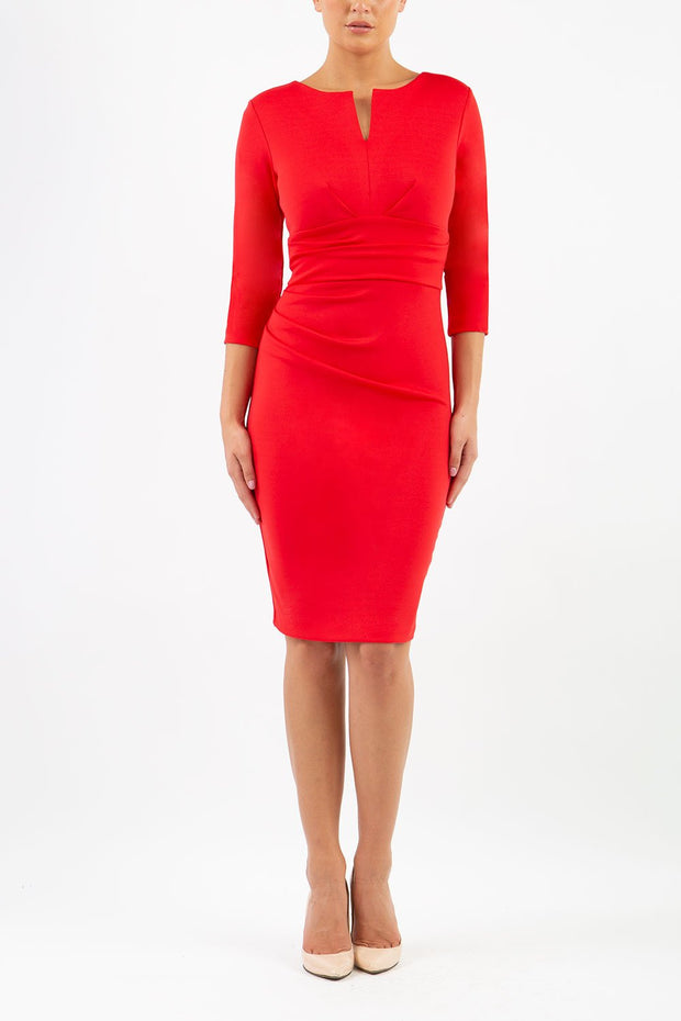 model wearing diva catwalk donna pencil dress in red colour with wide band and sleeves and rounded neckline with low split in front