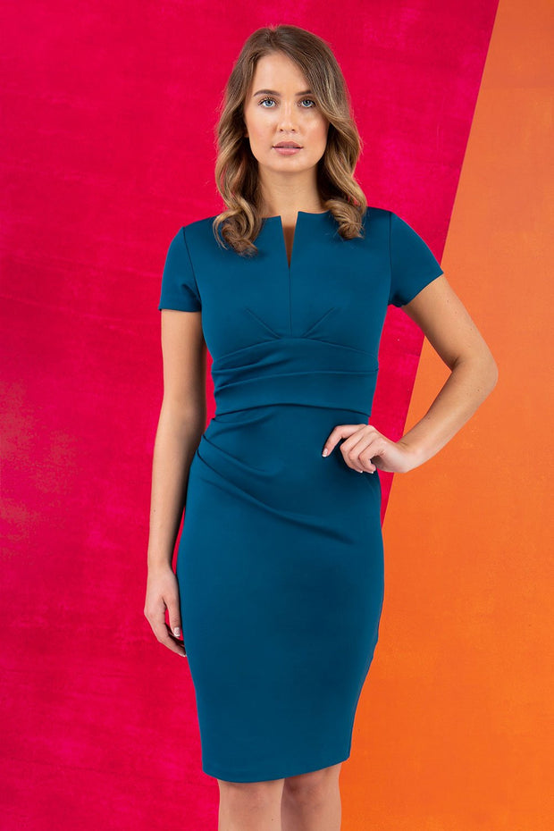 Model wearing Diva Catwalk Donna Short Sleeve Pencil Dress with a wide band and pleating across the tummy area in Glorious Teal front