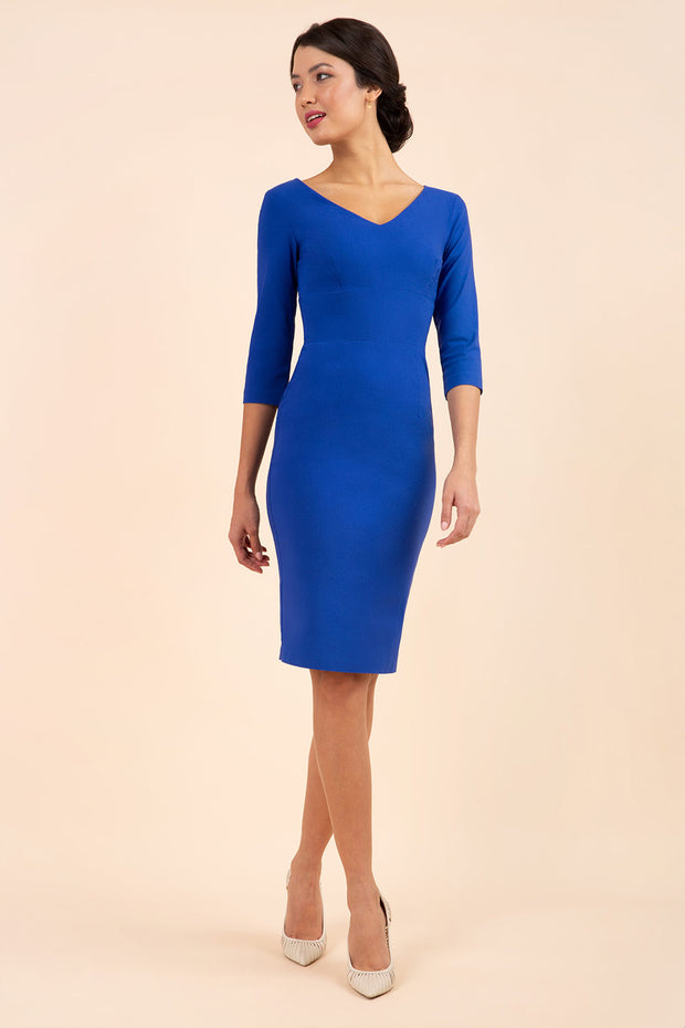 brunette model wearing diva catwalk natalie pencil-skirt dress with sleeves and v-neckline in royal blue front