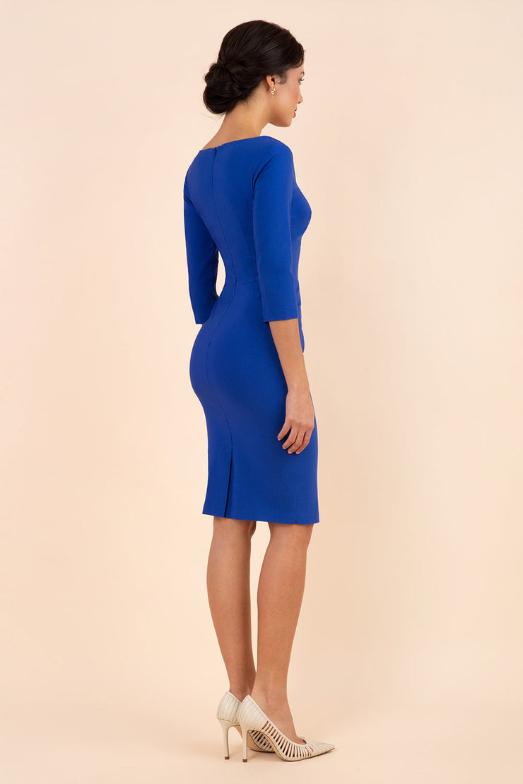 brunette model wearing diva catwalk natalie pencil-skirt dress with sleeves and v-neckline in royal blue back