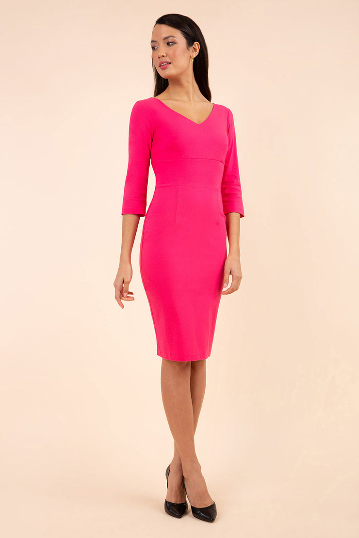 brunette model wearing diva catwalk natalie pencil-skirt dress with sleeves and v-neckline in pink front
