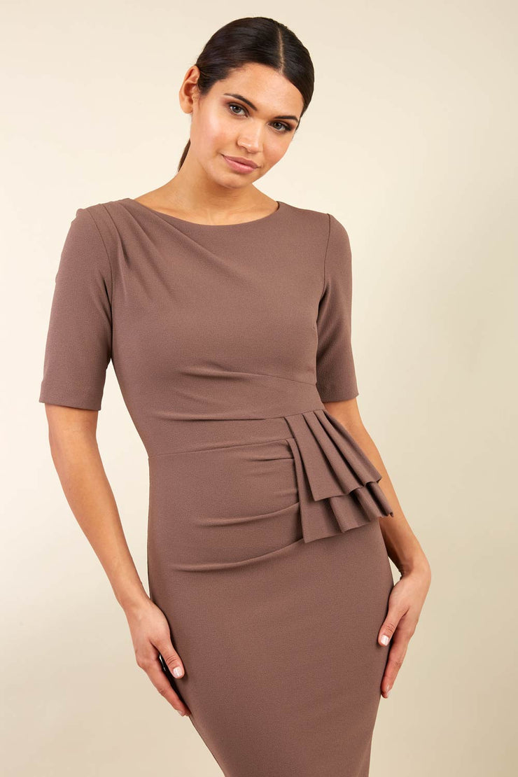 Model wearing the Diva Lynette dress in pencil dress design in peppercorn brown front image