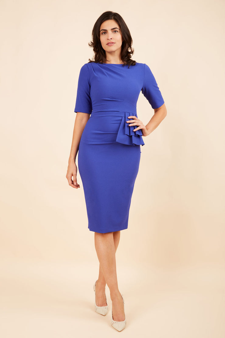 Model wearing the Diva Lynette dress in pencil dress design in blue front image