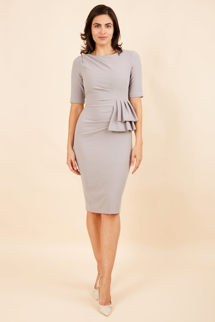 Model wearing the Diva Lynette dress in pencil dress design in grey front image