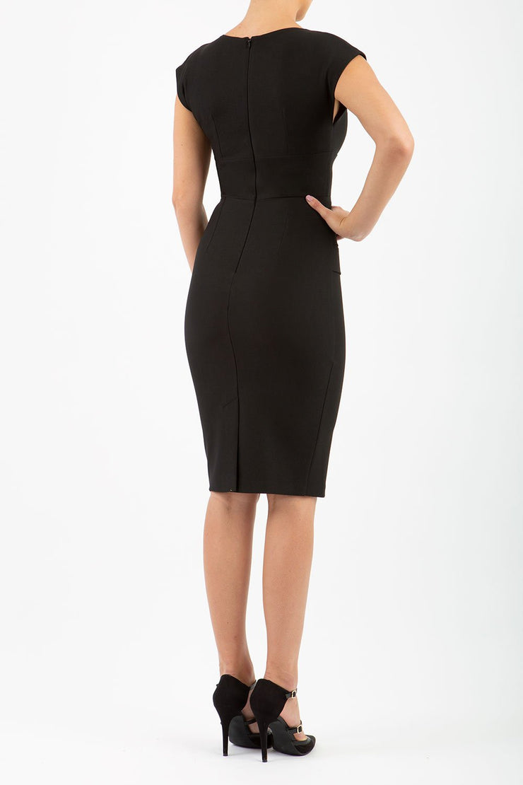 model wearing diva catwalk daphne sleeveless little black  pencil dress with rounded neckline with split in the middle