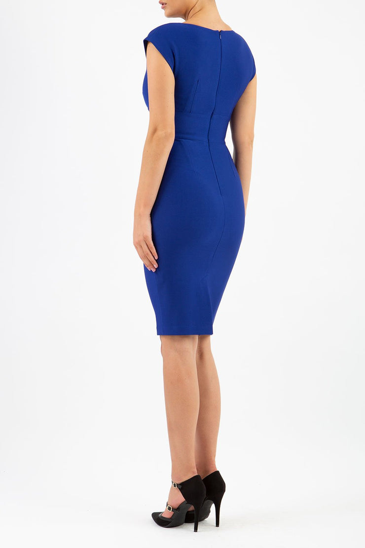 model wearing diva catwalk daphne sleeveless royal blue pencil dress with rounded neckline with split in the middle in back