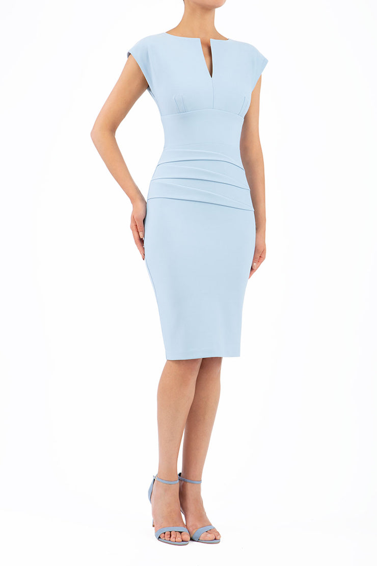 model wearing diva catwalk daphne sleeveless blue pencil dress with rounded neckline with split in the middle in front