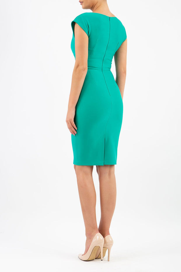 Model wearing the Diva Daphne Pencil with split neckline, sleeveless in emerald green back image