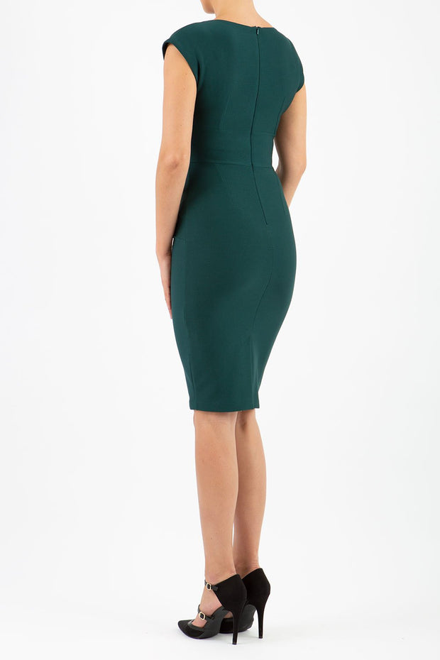 model wearing diva catwalk daphne sleeveless dark green pencil dress with rounded neckline with split in the middle in front