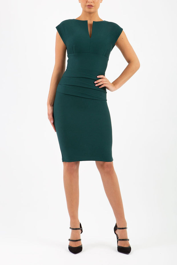 Model wearing the Diva Daphne Pencil with split neckline, sleeveless in forest green front image