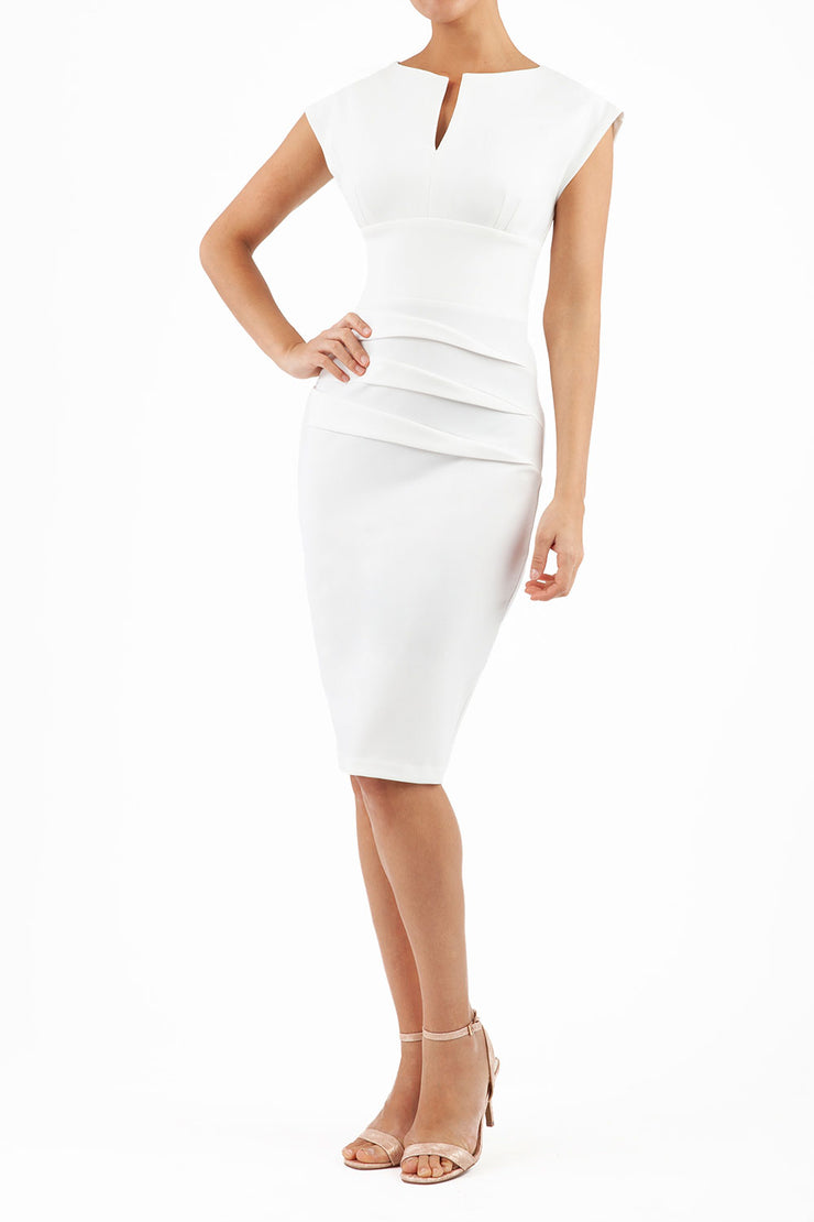 model wearing diva catwalk daphne sleeveless white pencil dress with rounded neckline with split in the middle in front