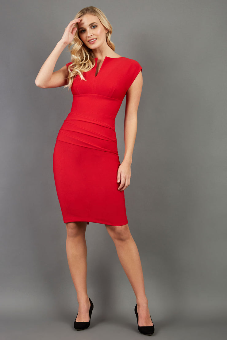 model wearing diva catwalk daphne sleeveless pencil skirt dress with rounded neckline with split in the middle in electric red colour front