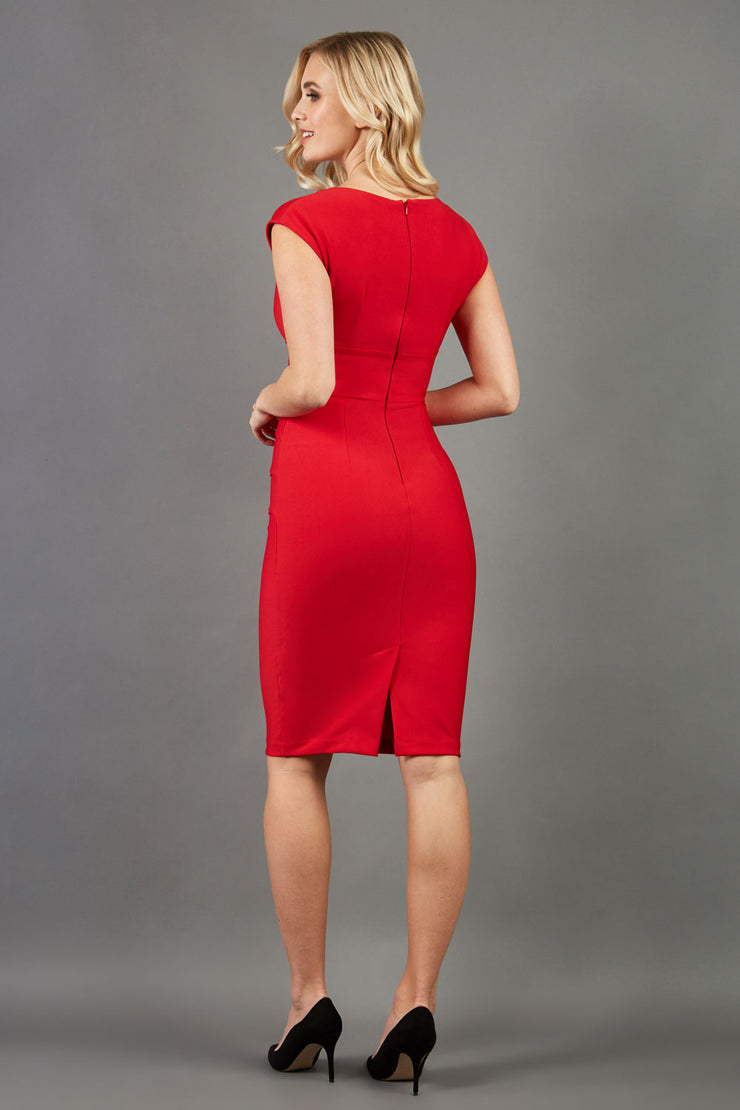 model wearing diva catwalk daphne sleeveless pencil skirt dress with rounded neckline with split in the middle in electric red colour back