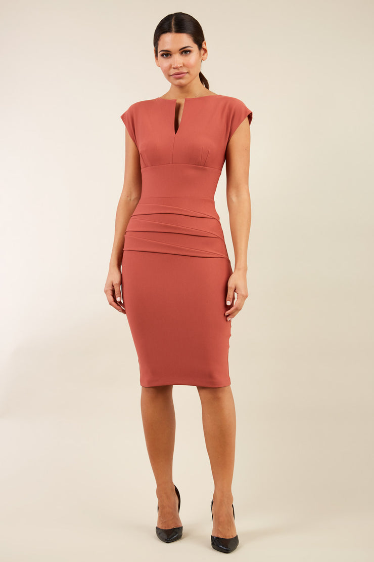 model wearing diva catwalk daphne sleeveless marsala brown  pencil dress with rounded neckline with split in the middle in front