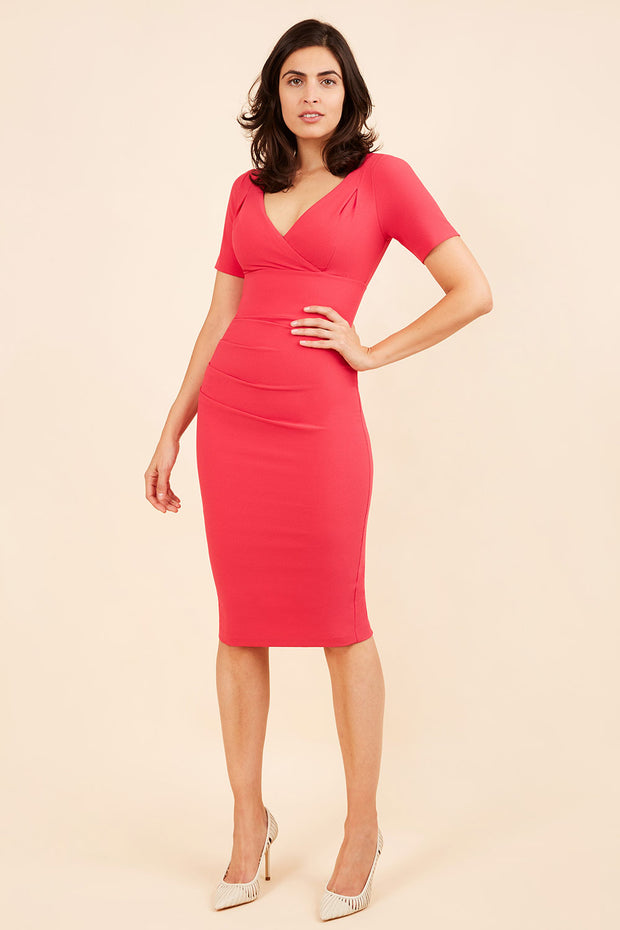 Model wearing the Diva Opal dress in pencil dress design in pink front image