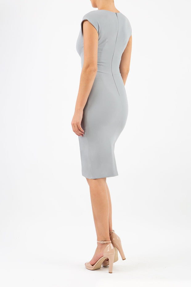 Model wearing the Diva Sylvia dress in pencil dress design in frost grey back image