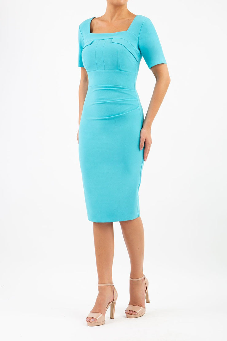 Model wearing the Diva Mollie dress in pencil dress design in celeste blue front image