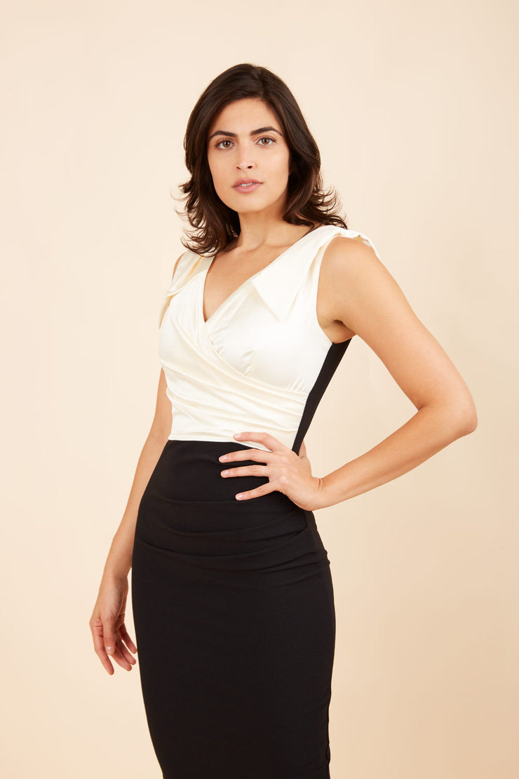Model wearing the Diva Broadway Satin dress with satin bodice to front and pleating at the front in cream and black back image