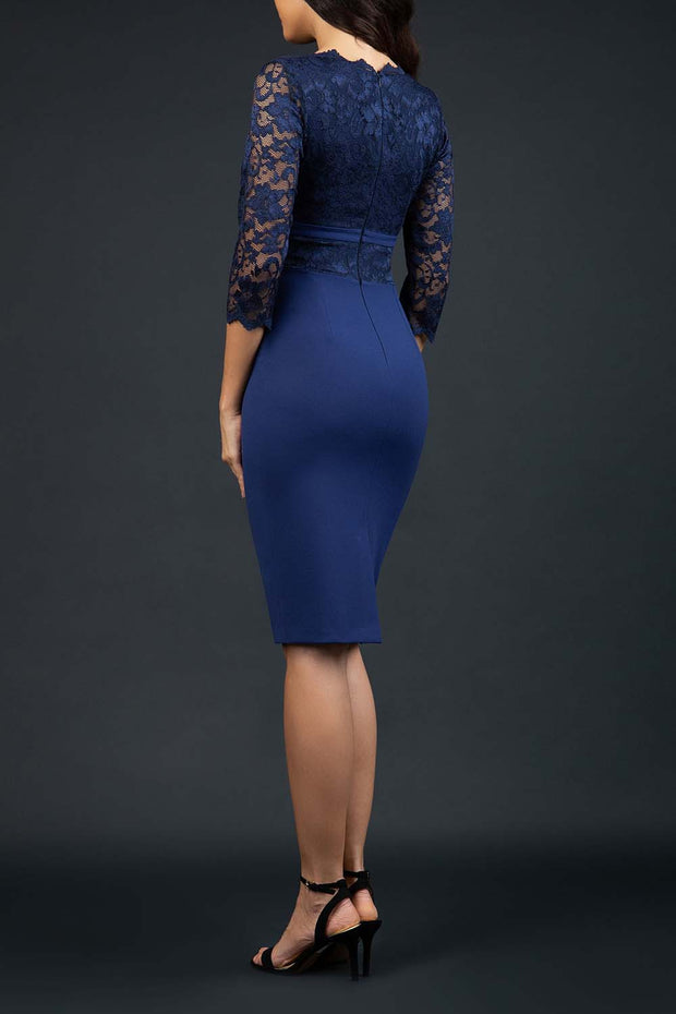 Model wearing the Diva Ivana Lace dress in pencil dress design in navy blue back image