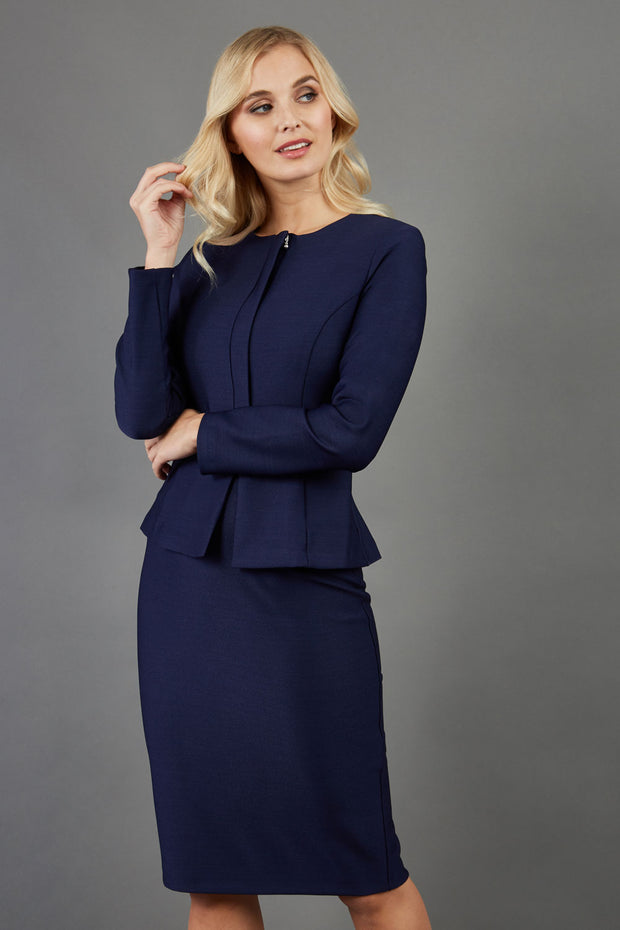 blonde model is wearing seed diva dawlish navy pencil skirt paired with jacket in navy front