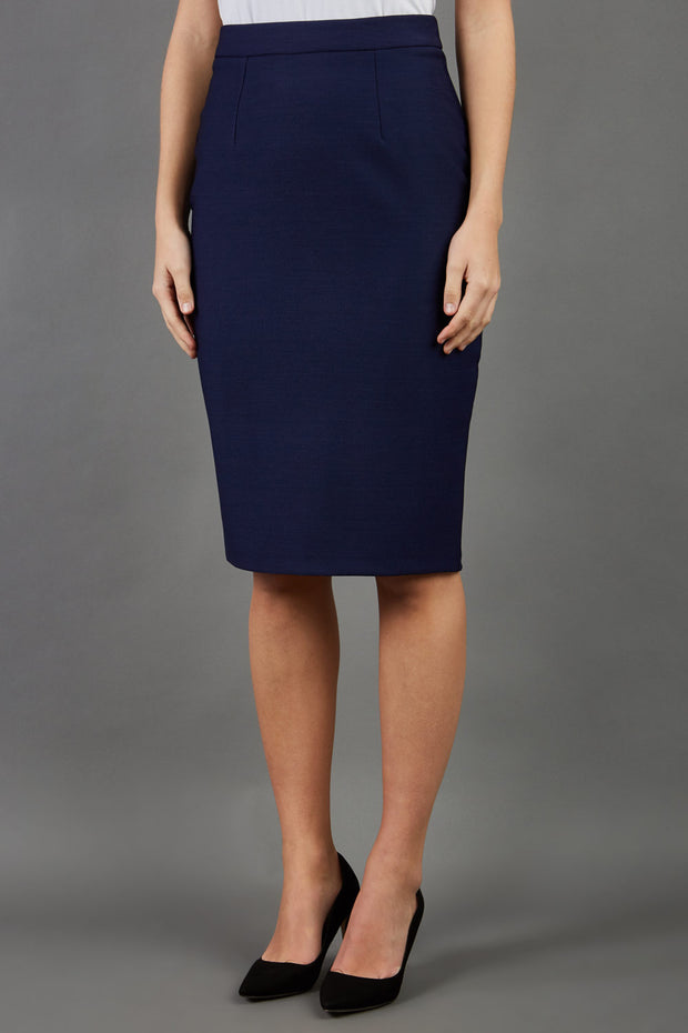 blonde model is wearing seed diva dawlish navy pencil skirt front