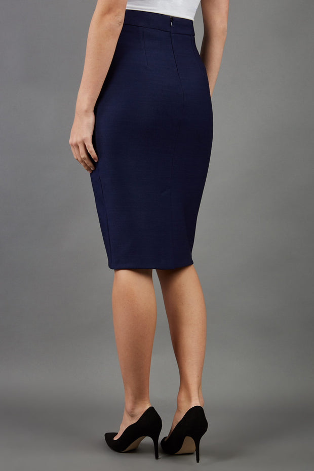blonde model is wearing seed diva dawlish navy pencil skirt back