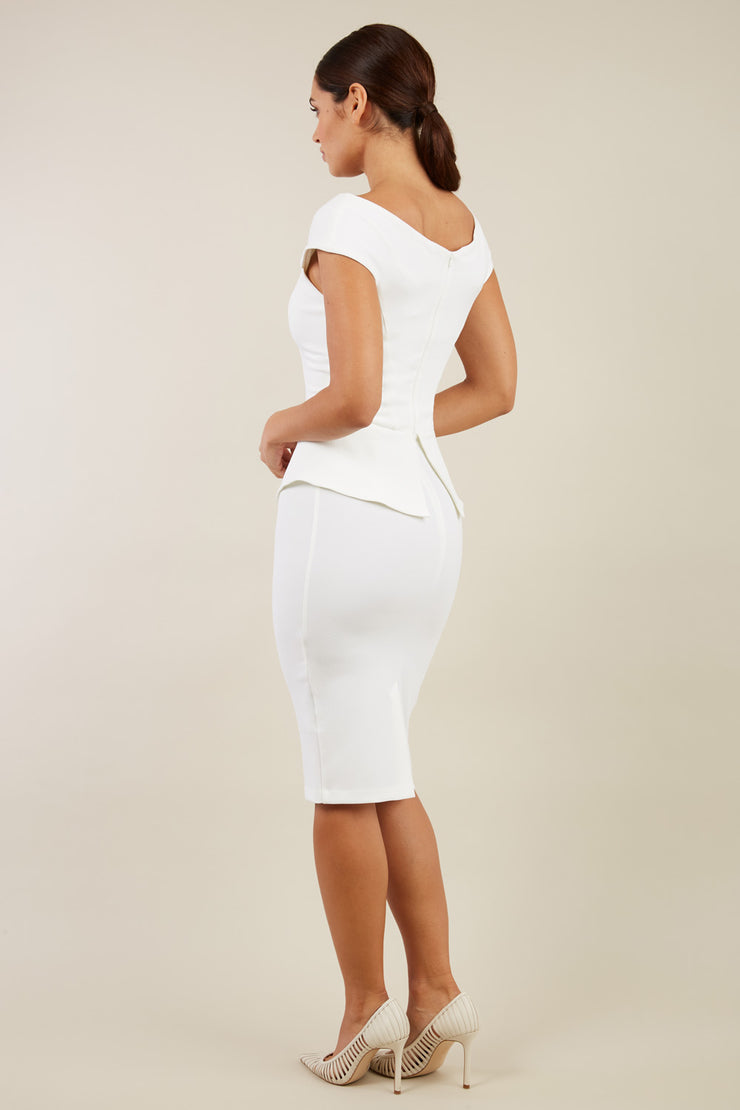 Model wearing the Diva Azalea Peplum dress with semi V neckline and peplum waistline in ivory back image