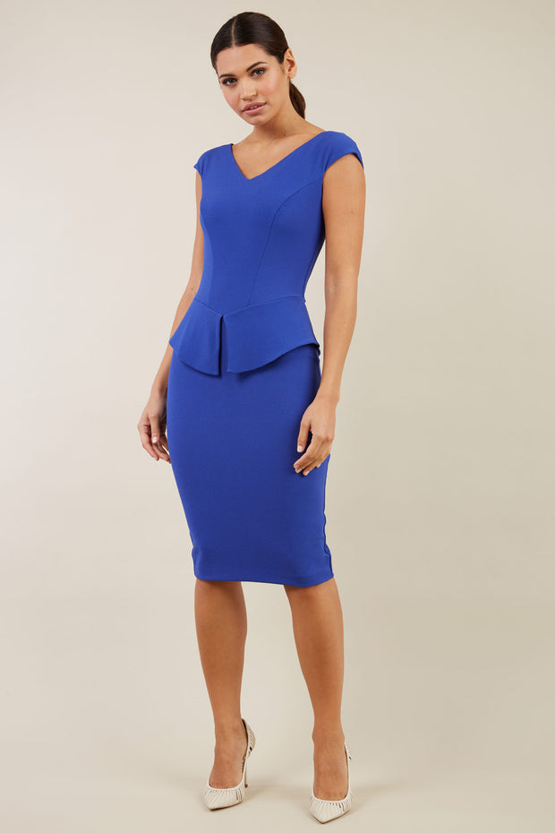 Model wearing the Diva Azalea Peplum dress with semi V neckline and peplum waistline in riviera blue front image