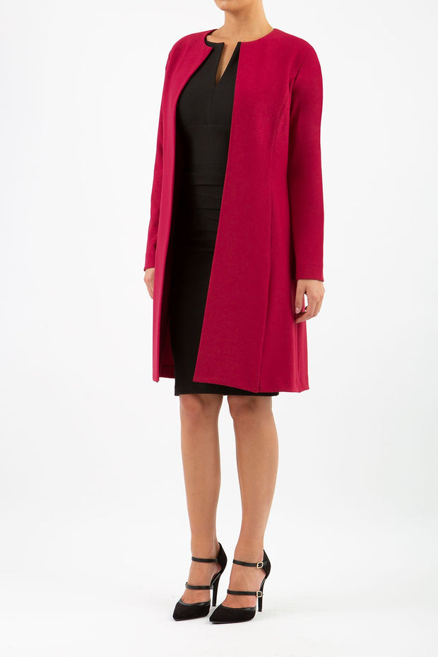 model wearing diva catwalk beet red coat with long sleeves and a belt front