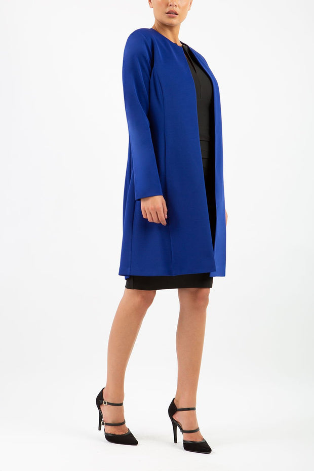 model wearing diva catwalk royal blue coat with long sleeves and a belt front