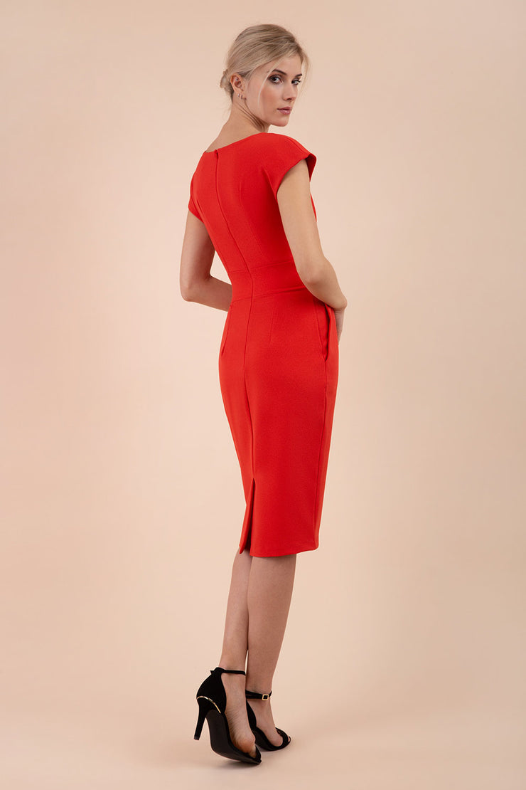 Model wearing the Diva Atara dress in pencil dress design in fiesta orange back image