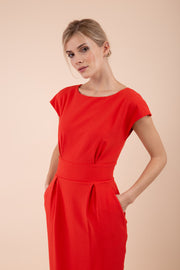 Model wearing the Diva Atara dress in pencil dress design in fiesta orange front image