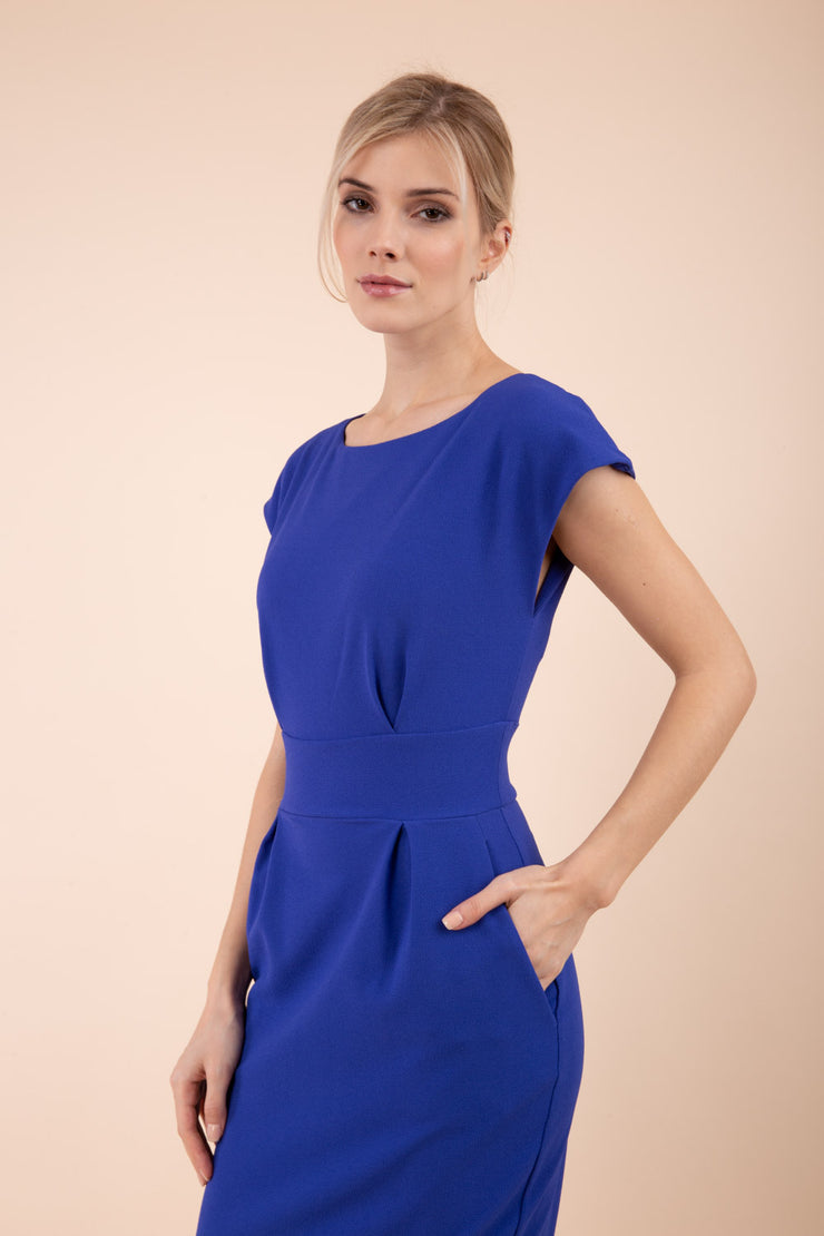 Model wearing the Diva Atara dress in pencil dress design in riviera blue front image