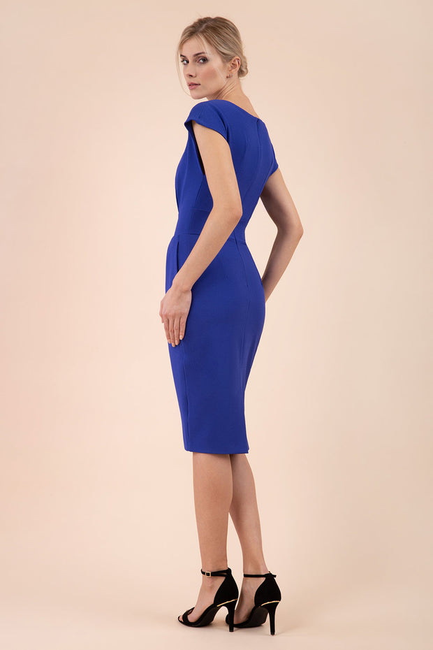 Model wearing the Diva Atara dress in pencil dress design in riviera blue back image