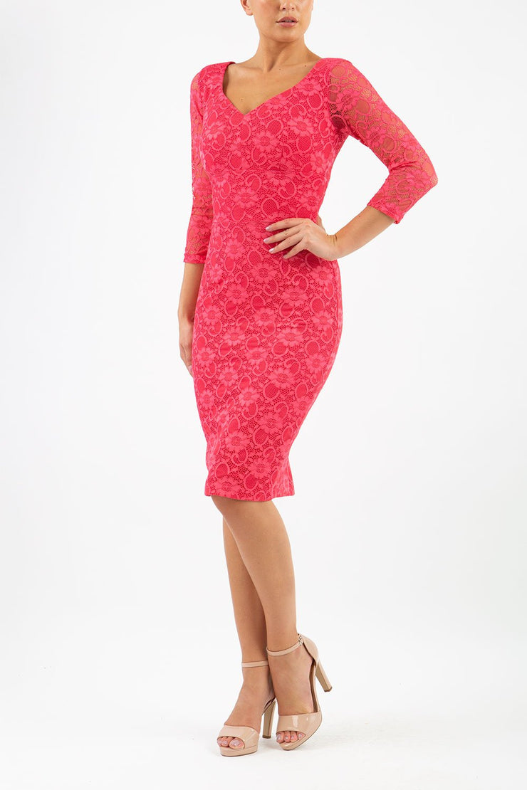 Model wearing Diva Bucklebury Lace pencil dress with sleeves in ripple crepe and stretch lace fabric in coral lace front