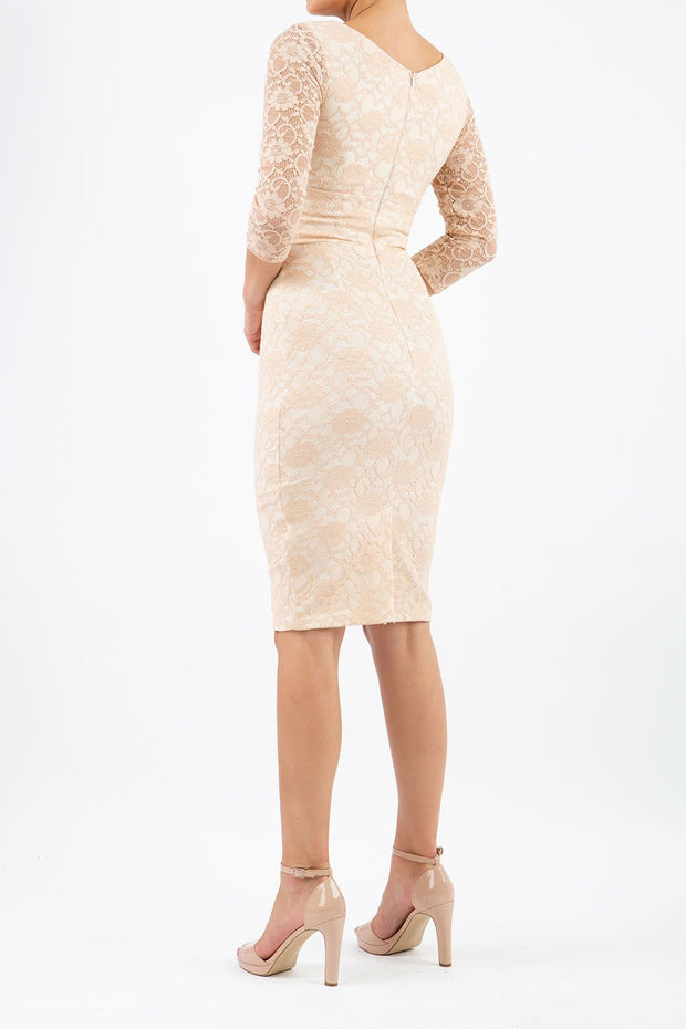 Model wearing Diva Bucklebury red Lace pencil dress with sleeves in ripple crepe and stretch lace fabric in beige lace back