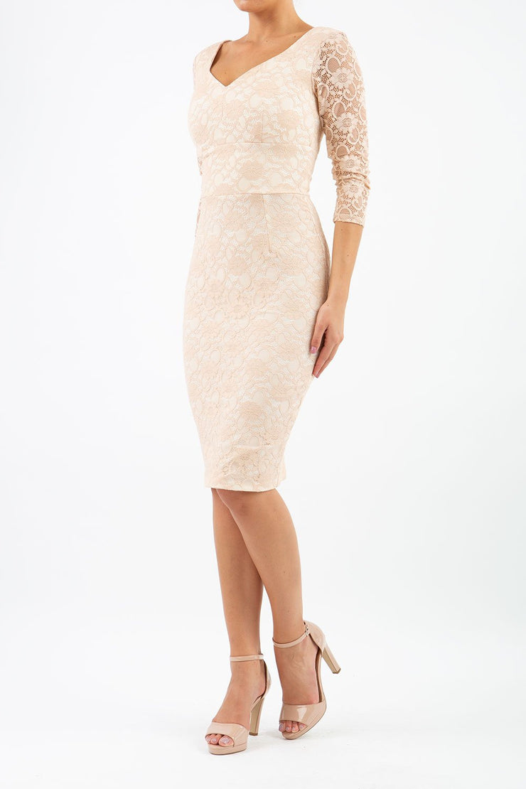 Model wearing Diva Bucklebury Lace pencil dress with sleeves in ripple crepe and stretch lace fabric in cream lace front